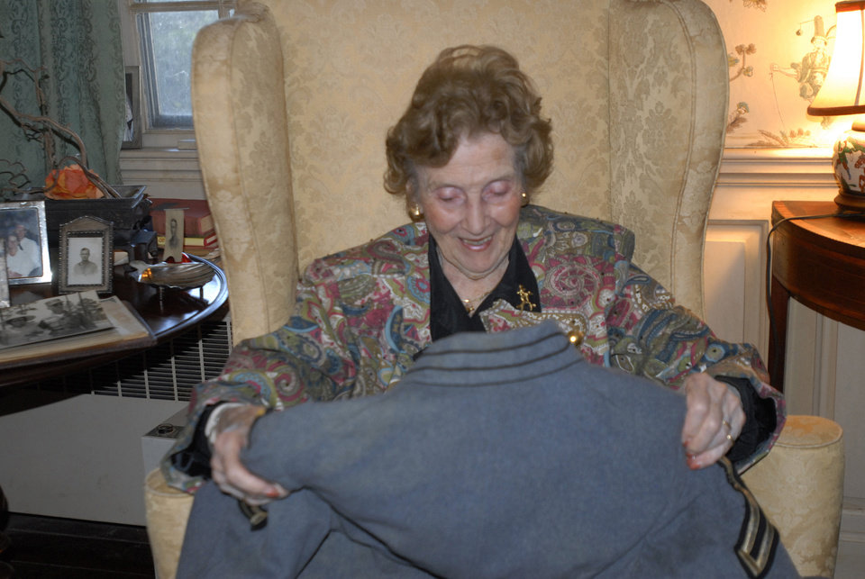 In this photo taken Wednesday, Nov. 28, 2012, Teresa deGavre smiles as she looks at her late husband\'s West Point uniform jacket at her home near Onancock, Va. The Chester B. deGavre\'s jacket was discovered on a beach in New Jersey after Superstorm Sandy by Donna Gugger of Holland, Pa. who returned it Wednesday. (AP Photo/Eastern Shore News, Malissa Watterson) NO SALES