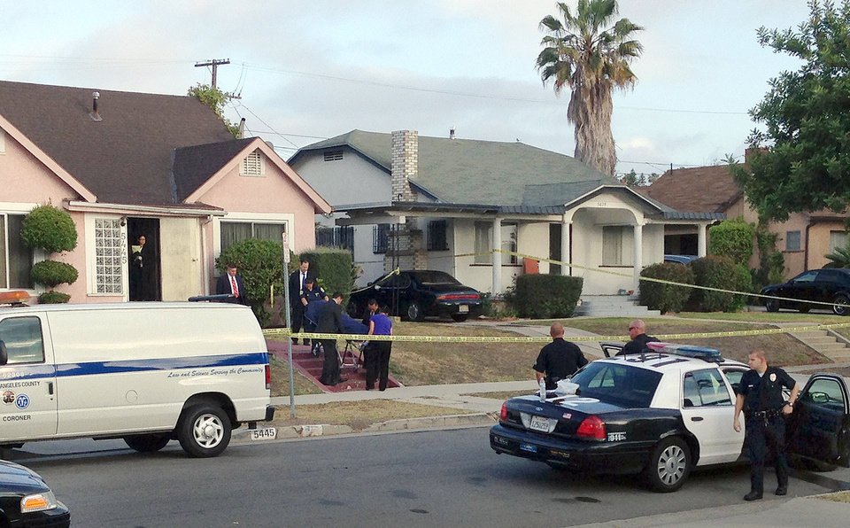 Photo - Los Angeles County coroner's officials remove the body of April Jace, the wife of actor Michael Jace, from the couple's home in the Hyde Park area of Los Angeles Tuesday morning, May 20, 2014. Michael Jace, who played a police officer on the hit TV show