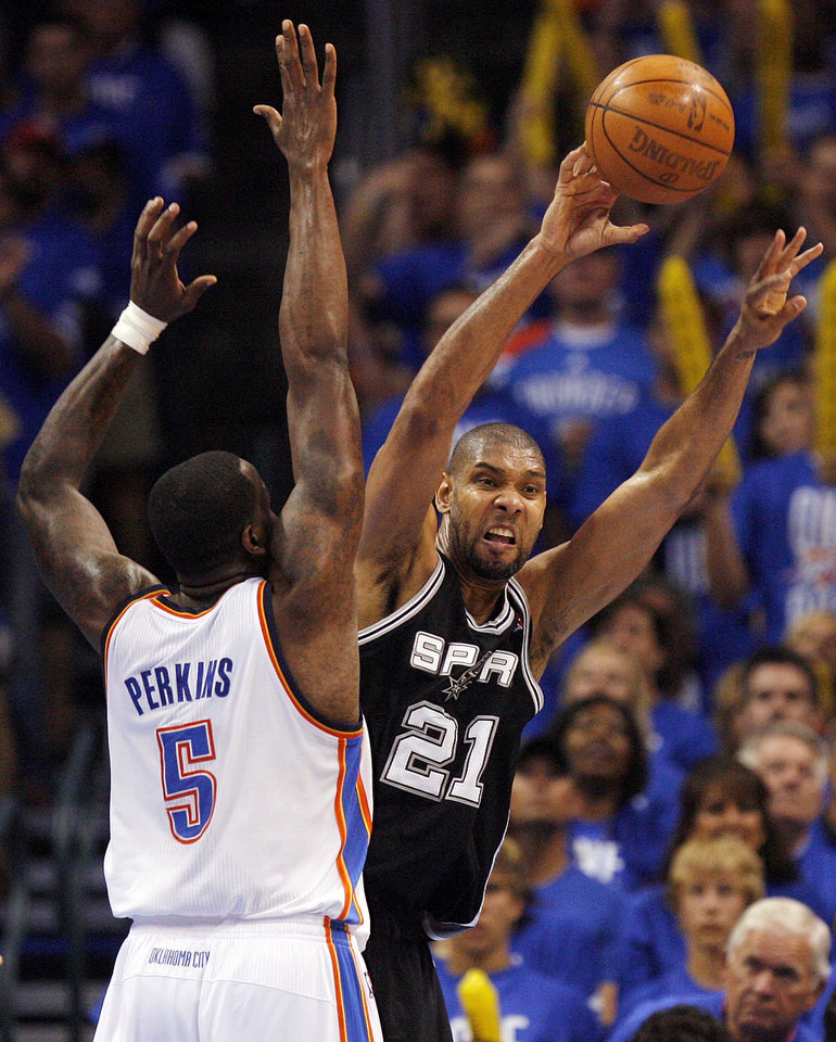 San Antonio's Tim Duncan (21) passes around Oklahoma City's Kendrick Perkins (5) during Game 3 of the Western Conference Finals between the Oklahoma City Thunder and the San Antonio Spurs in the NBA playoffs at the Chesapeake Energy Arena in Oklahoma City, Thursday, May 31, 2012. Oklahoma City won, 102-82. Photo by Nate Billings, The Oklahoman