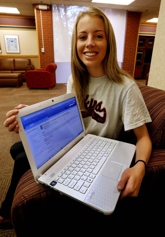 Freshman student Mandi Gatlin shows an e-textbook she used in a sociology class this year at the University of Oklahoma (OU) on Thursday, May 9, 2013 in Norman, Okla. Photo by Steve Sisney, The Oklahoman