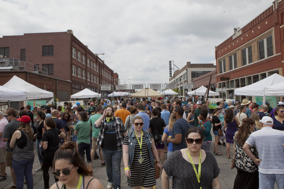 Photo - A crowd lines the front entrance of the beer garden at downtown Tulsa's Hop Jam Beer and Music Festival. [Photo by Nathan Poppe, The Oklahoman]