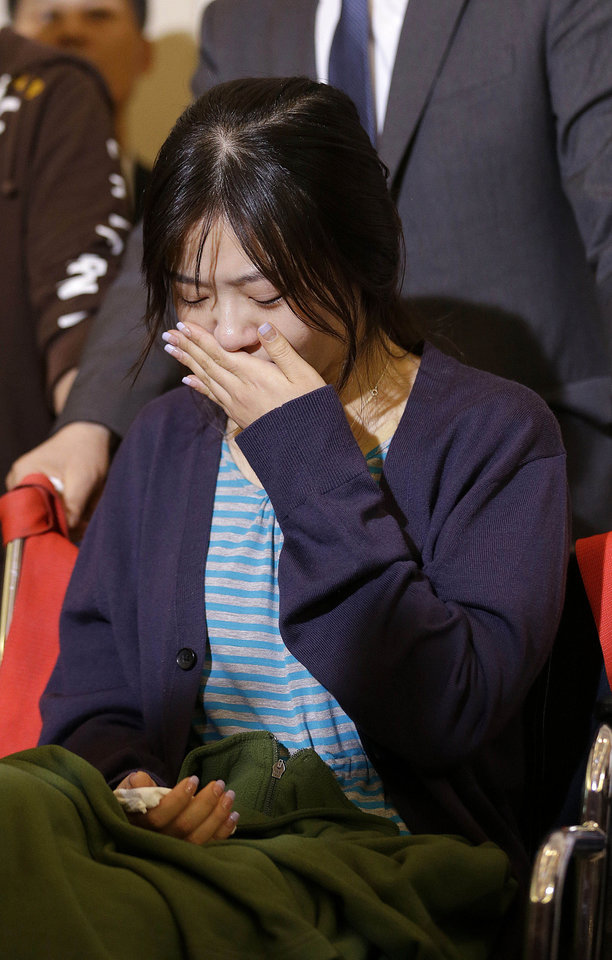 Photo - An unidentified flight attendant of Asiana Flight 214, which crashed on Saturday, July 6, 2013, cries during a news conference at San Francisco International Airport in San Francisco, Wednesday, July 10, 2013. Two passengers were killed and many others were injured in the crash. (AP Photo/Jeff Chiu)