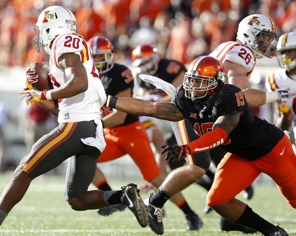 Photo - Iowa State's Kene Nwangwu (20) gets by Oklahoma State's Justin Phillips (19) in the third quarter during a college football game between the Oklahoma State University Cowboys (OSU) and the Iowa State University at Boone Pickens Stadium in Stillwater, Okla., Saturday, Oct. 8, 2016. Photo by Sarah Phipps, The Oklahoman