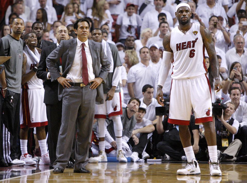 Photo - Miami coach Erik Spoelstra and LeBron James (6) watch during the final seconds of Game 3 of the NBA Finals between the Oklahoma City Thunder and the Miami Heat at American Airlines Arena, Sunday, June 17, 2012. Photo by Bryan Terry, The Oklahoman
