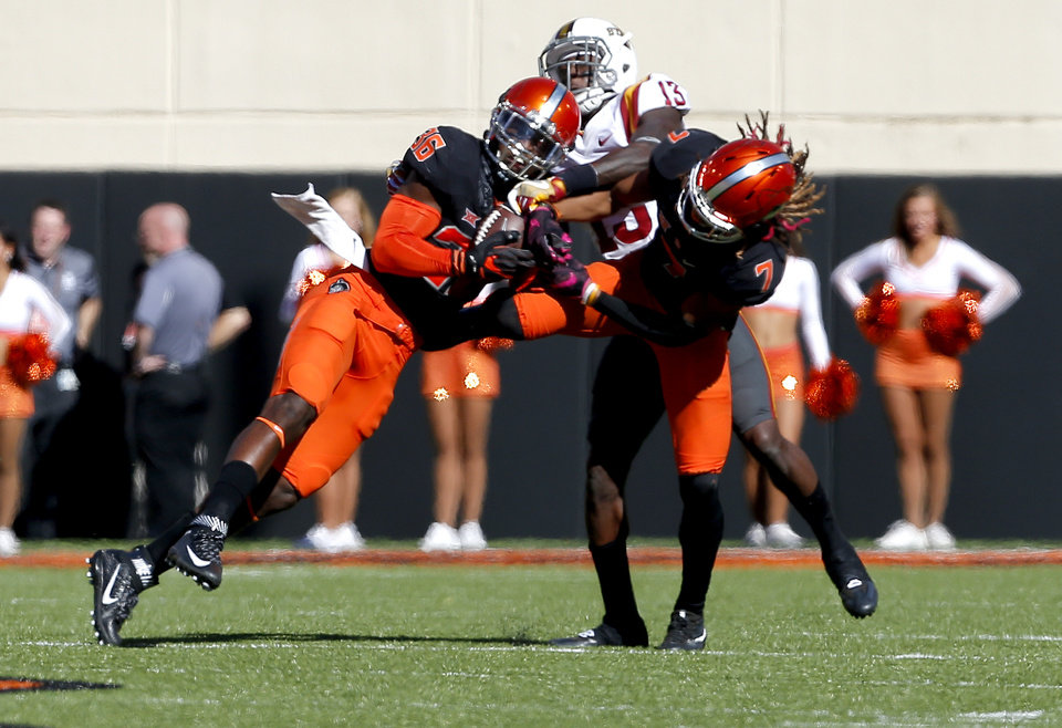 Photo - Oklahoma State's Derrick Moncrief (36) intercepts a pass intended for Iowa State's Dondre Daley (13) as Ramon Richards (7) also defends during a college football game between the Oklahoma State University Cowboys (OSU) and the Iowa State University at Boone Pickens Stadium in Stillwater, Okla., Saturday, Oct. 8, 2016. Photo by Sarah Phipps, The Oklahoman