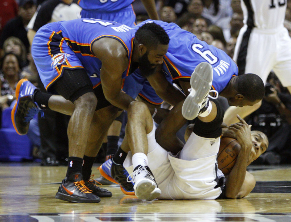 Oklahoma City's James Harden (13) and Oklahoma City's Serge Ibaka (9) fight with San Antonio's Tim Duncan for the ball during Game 2 of the Western Conference Finals between the Oklahoma City Thunder and the San Antonio Spurs in the NBA playoffs at the AT&T Center in San Antonio, Texas, Tuesday, May 29, 2012. Oklahoma City lost 120-111. Photo by Bryan Terry, The Oklahoman