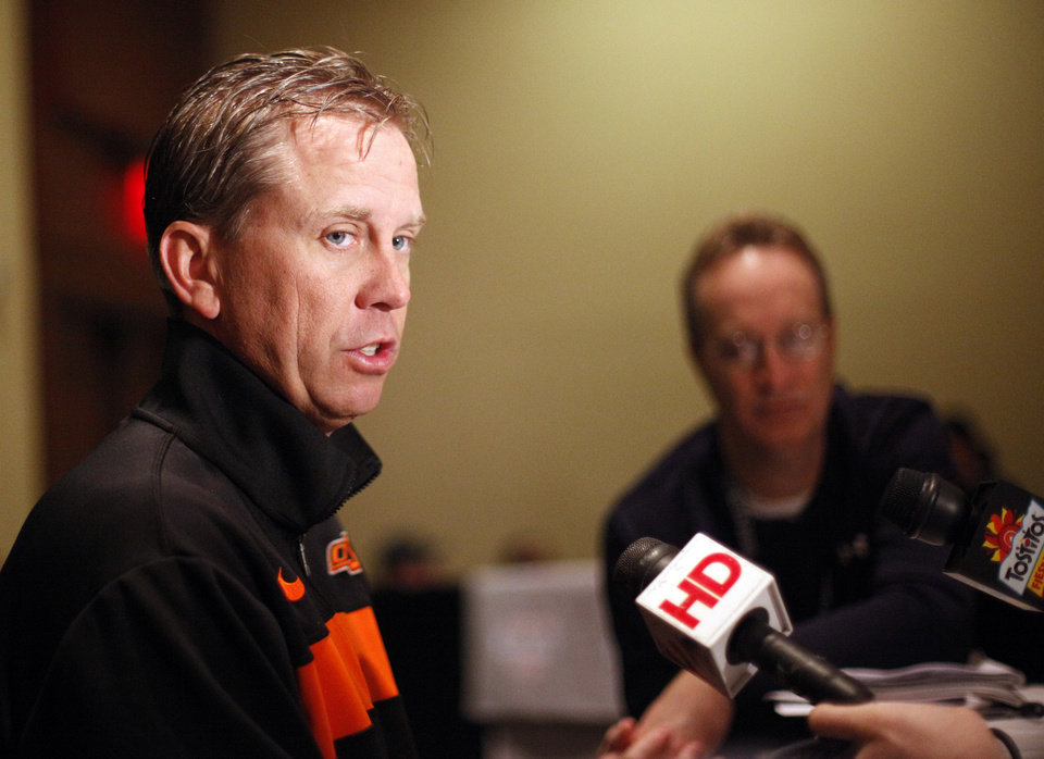 Photo - Oklahoma State's Todd Monken talks to the media during an Oklahoma State press conference for the Fiesta Bowl at the Camelback Inn in Paradise Valley, Ariz.,  Thursday, Dec. 29, 2011. Photo by Sarah Phipps, The Oklahoman