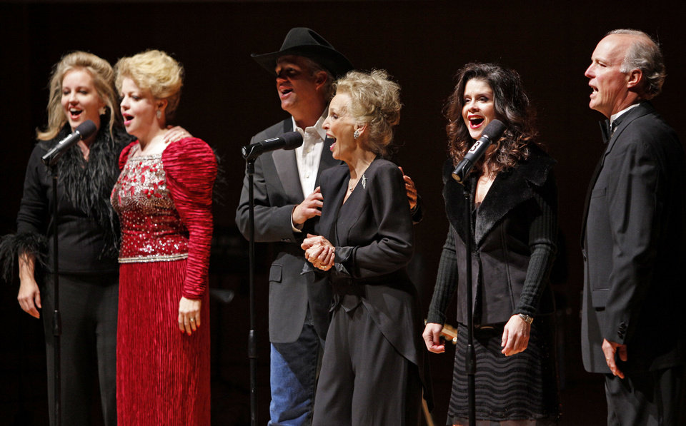 Photo -  From left, Stacy Sullivan, KT Sullivan, Tim Sullivan, Elizabeth Sullivan, Robin Brooks Sullivan, and Pat Sullivan perform during one of their annual Christmas concerts in Norman. The family will reunite Saturday for a benefit concert to honor Jim Sullivan. OKLAHOMAN ARCHIVES   BRYAN TERRY -