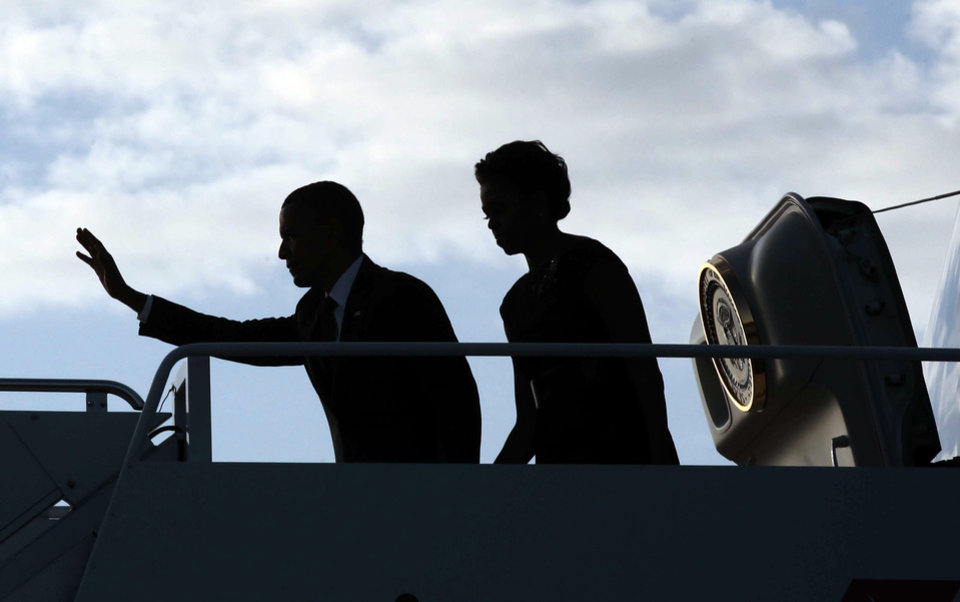 Photo -   President Barack Obama and first lady Michelle Obama are seen silhouetted during their arrival at JFK International airport Sunday, Sept., 11, 2011 in New York. (AP Photo/Pablo Martinez Monsivais)