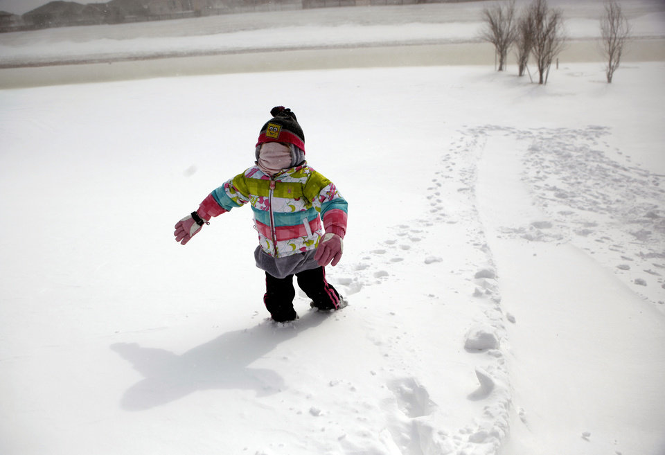SNOW / BLIZZARD / WINTER STORM / COLD WEATHER / CHILD / CHILDREN / KIDS: Natalyn Varney, 5, walks up a hill after sledding in northwest Oklahoma City neighborhood, Tuesday, Feb. 1, 2011. Photo by Sarah Phipps, The Oklahoman  ORG XMIT: KOD