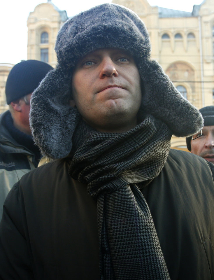 Photo - Russian opposition leader Alexei Navalny arrives at an unauthorized rally in Lubyanka Square in Moscow, Russia, Saturday, Dec. 15, 2012. Thousands of opposition supporters gathered Saturday in central Moscow for an unauthorized rally to mark a year of a wave of massive protests against Vladimir Putin and the government. Several prominent opposition figures were detained in the course of the gathering, which was not sanctioned by authorities. (AP Photo/Misha Japaridze)