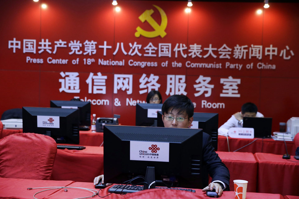 Photo -   A Chinese man uses a computer at the press center of the 18th Communist Party Congress in Beijing, China, Tuesday, Nov. 13, 2012. During China's last party congress, the cadres in charge of the world's most populous nation didn't know a hashtag from a hyperlink. But five years on, there's a new message from Beijing: The political transition will be microblogged. (AP Photo/Ng Han Guan)