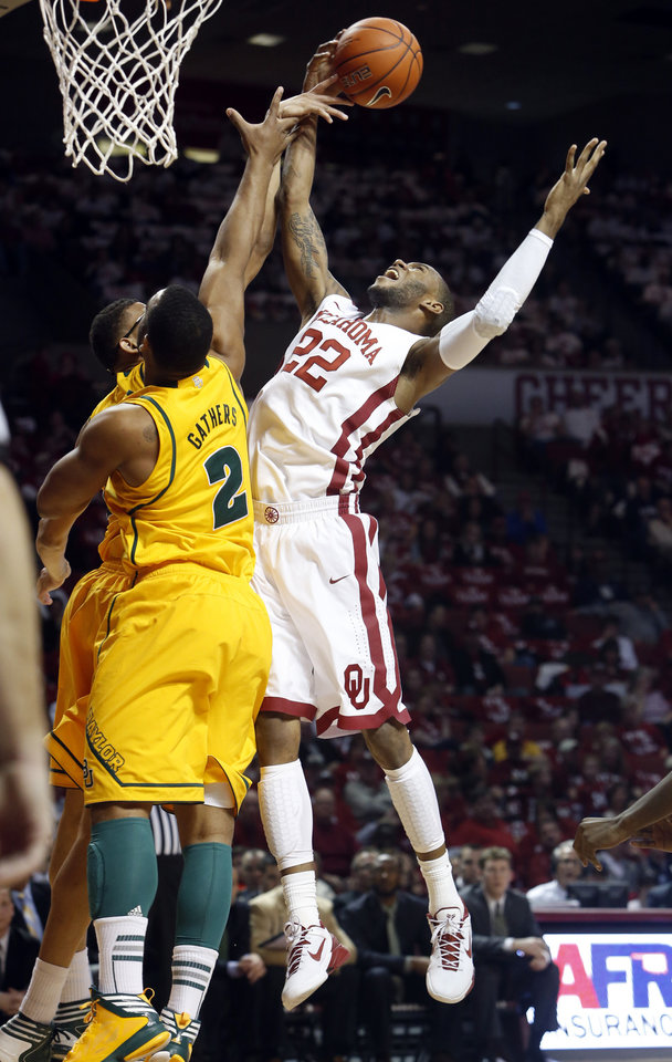 Oklahoma Sooner\'s Amath M\'Baye (22) has a shot blocked by Baylor Bear\'s Isaiah Austin (21) as the University of Oklahoma Sooners (OU) men play the Baylor University Bears (BU) in NCAA, college basketball at The Lloyd Noble Center on Saturday, Feb. 23, 2013 in Norman, Okla. Photo by Steve Sisney, The Oklahoman