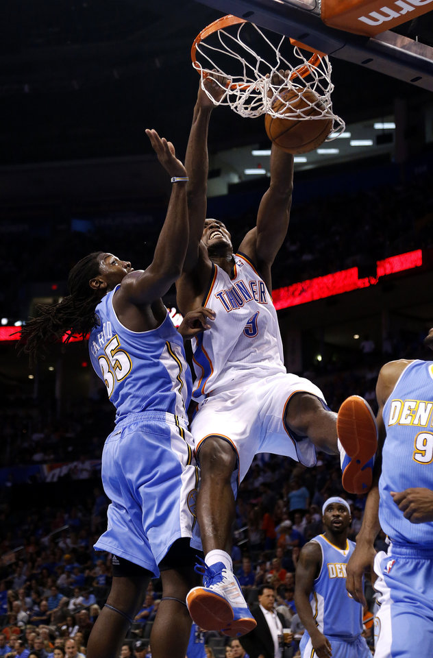 Oklahoma City's Serge Ibaka (9) dunks over Denver's Kenneth Faried (35) during the NBA preseason basketball game between the Oklahoma City Thunder and the Denver Nuggets at the Chesapeake Energy Arena, Sunday, Oct. 21, 2012. Photo by Sarah Phipps, The Oklahoman
