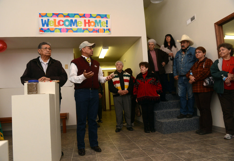 FILE - In this Saturday, Nov. 3, 2012 file photo, Henry Anderson, left, and James Parker Shield welcome people to the new Little Shell Chippewa Cree Visitor Center in Montana. Montana\'s Little Shell tribe appeared poised to fade from history in recent years after it was denied federal government recognition, lost its financial support from the state and saw its elected leadership splinter. But the past year has brought a sharp turnaround for the 4,500-member landless tribe that long has existed on society\'s fringe. Tribal enrollment is on the rise. Government grant money is flowing again, and the Little Shell cultural and visitor center opened this month in Great Falls. (AP Photo/The Great Falls Tribune, Rion Sanders) NO SALES