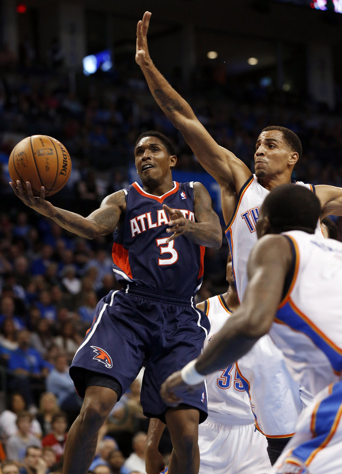 Photo - Atlanta Hawk's Louis Williams (3) shoots past Oklahoma City Thunder's Thabo Sefolosha (2) as the Atlanta Hawks defeat the Oklahoma City Thunder 104-95 in NBA basketball at the Chesapeake Energy Arena in Oklahoma City, on Sunday, Nov. 4, 2012.  Photo by Steve Sisney, The Oklahoman