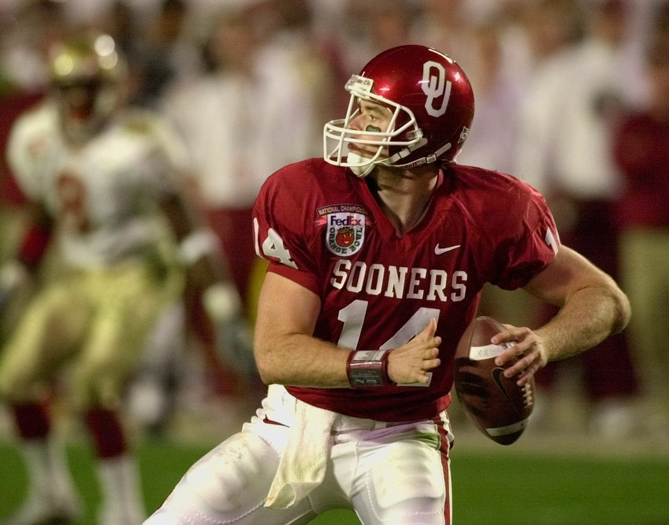 Photo - NATIONAL CHAMPIONSHIP, COLLEGE FOOTBALL: OU quarterback Josh Heupel looks for a receiver during the first half against Florida State in the Orange Bowl Wednesday, Jan. 3, 2001 at Pro Player Stadium in Miami, Fla. (AP Photo/Chris O'Meara