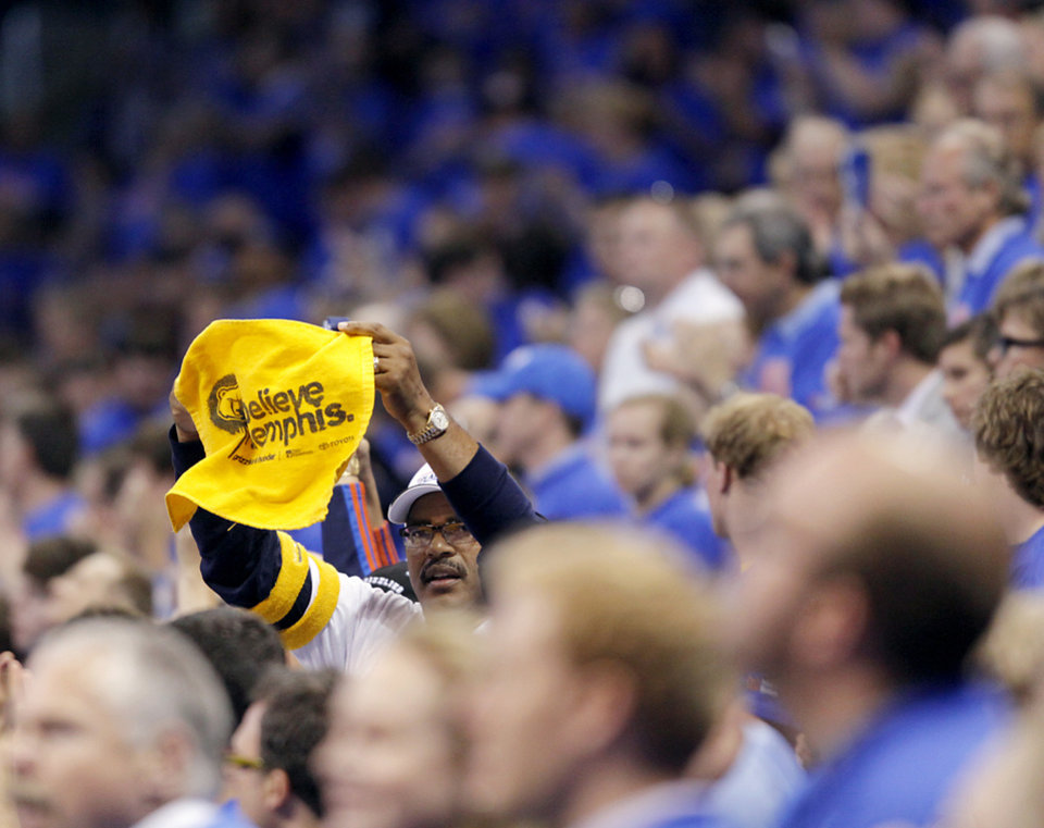 "Grizzlies fan Stanley Blue holds up a ""Believe Memphis"" towel during the first half of game 7 of the NBA basketball Western Conference semifinals between the Memphis Grizzlies and the Oklahoma City Thunder at the OKC Arena in Oklahoma City, Sunday, May 15, 2011. Photo by John Clanton, The Oklahoman"