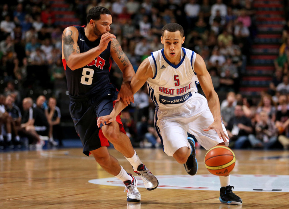 Photo -   Great Britain's Andrew Lawrence, right, gets past USA's Deron Williams during an Olympic Warm Up match against the USA at the Manchester Arena, Manchester Thursday July 19, 2012. (AP Photo/ Dave Thompson/PA Wire) UNITED KINGDOM OUT