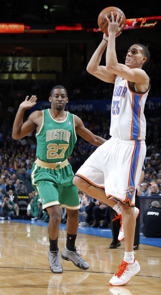Oklahoma City's Kevin Martin (23) shoots a basket in front of Boston's Jordan Crawford (27) during the NBA game between the Oklahoma City Thunder and the Boston Celtics at the Chesapeake Energy Arena in Oklahoma City, Sunday, March 10, 2013. Photo by Sarah Phipps, The Oklahoman