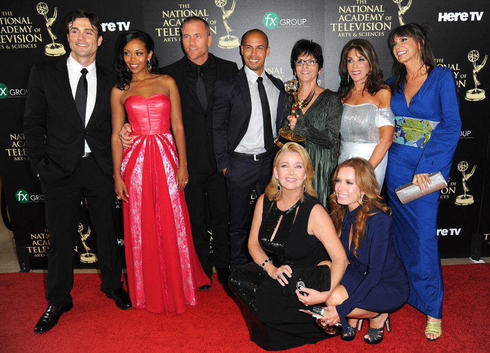 """Photo - The cast and crew of """"The Young and the Restless"""" poses in the press room with the award for outstanding drama series at the 41st annual Daytime Emmy Awards at the Beverly Hilton Hotel on Sunday, June 22, 2014, in Beverly Hills, Calif. (Photo by Richard Shotwell/Invision/AP)"""