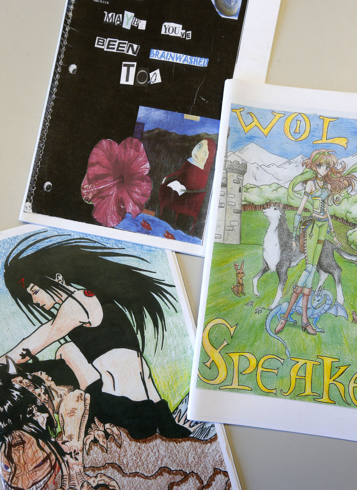 Photo - Zines are seen Thursday with examples of an entry in the Metropolitan Library System's Fan Fiction and Fan Art Contest at Southern Oaks Library in Oklahoma City. Photo by Bryan Terry, The Oklahoman  BRYAN TERRY