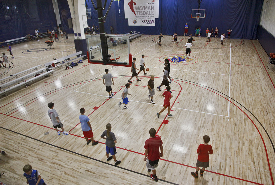 Photo - Campers take their game to the court during Los Angeles Clippers Blake Griffin's basketball camp held at the Santa Fe Family Life Center on Wednesday, Aug. 2, 2011, in Oklahoma City, Okla. Photo by Chris Landsberger, The Oklahoman