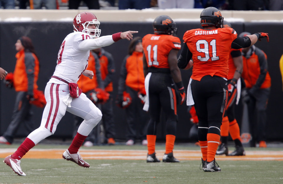 Photo - Oklahoma's Blake Bell (10) reacts to the sideline after throwing the go ahead touchdown during the Bedlam college football game between the Oklahoma State University Cowboys (OSU) and the University of Oklahoma Sooners (OU) at Boone Pickens Stadium in Stillwater, Okla., Saturday, Dec. 7, 2013. Photo by Chris Landsberger, The Oklahoman