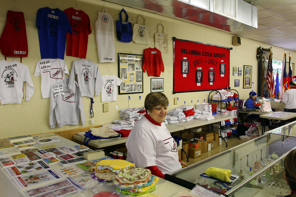 Photo - Cindy Fridrich has plenty of souvenirs for sale during the 47th annual Czech Festival Saturday in Yukon. PHOTO BY HUGH SCOTT FOR THE OKLAHOMAN