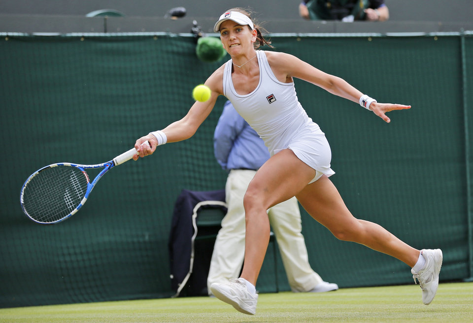 Photo - Chanelle Scheepers of South Africa plays a return to Serena Williams of the U.S. during their women's singles match at the All England Lawn Tennis Championships in Wimbledon, London, Thursday, June 26, 2014. (AP Photo/Ben Curtis)