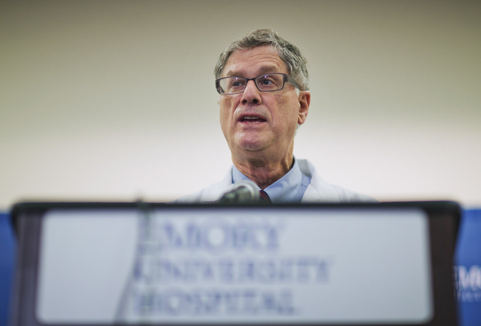 Photo - Dr. Bruce Ribner, the Emory University Hospital epidemiologist who oversees the isolated unit at the hospital set up to treat patients exposed to certain infectious diseases, speaks at a news conference, Friday, Aug. 1, 2014, in Atlanta. Ribner said Friday two American aid workers infected with the Ebola virus in Africa will be treated at Emory University Hospital. (AP Photo/David Goldman)