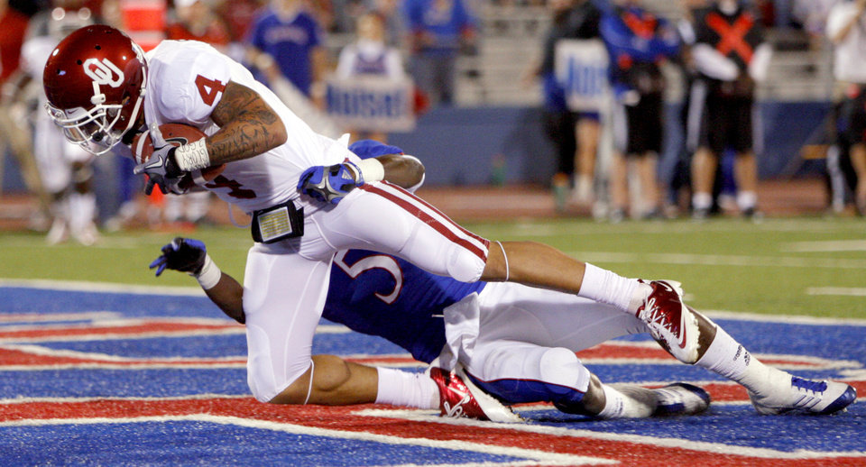 Photo - Oklahoma's Kenny Stills (4) catches a touchdown pass beside Kansas' Greg Brown (5) during the college football game between the University of Oklahoma Sooners (OU) and the University of Kansas Jayhawks (KU) at Memorial Stadium in Lawrence, Kansas, Saturday, Oct. 15, 2011. Photo by Bryan Terry, The Oklahoman