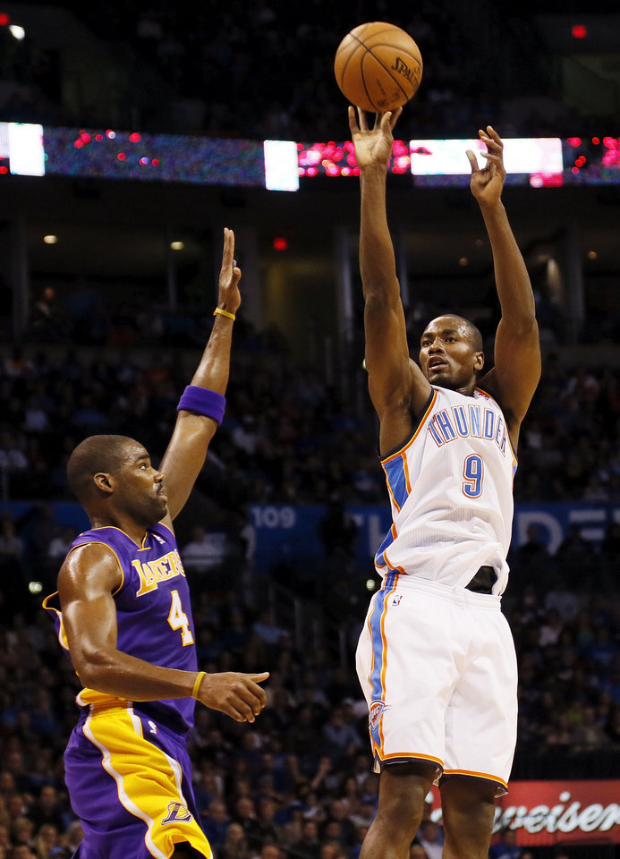 Photo - Oklahoma City's Serge Ibaka (9) shoots against Los Angeles' Antawn Jamison (4) during an NBA basketball game between the Oklahoma City Thunder and the Los Angeles Lakers at Chesapeake Energy Arena in Oklahoma City, Friday, Dec. 7, 2012. Photo by Nate Billings, The Oklahoman