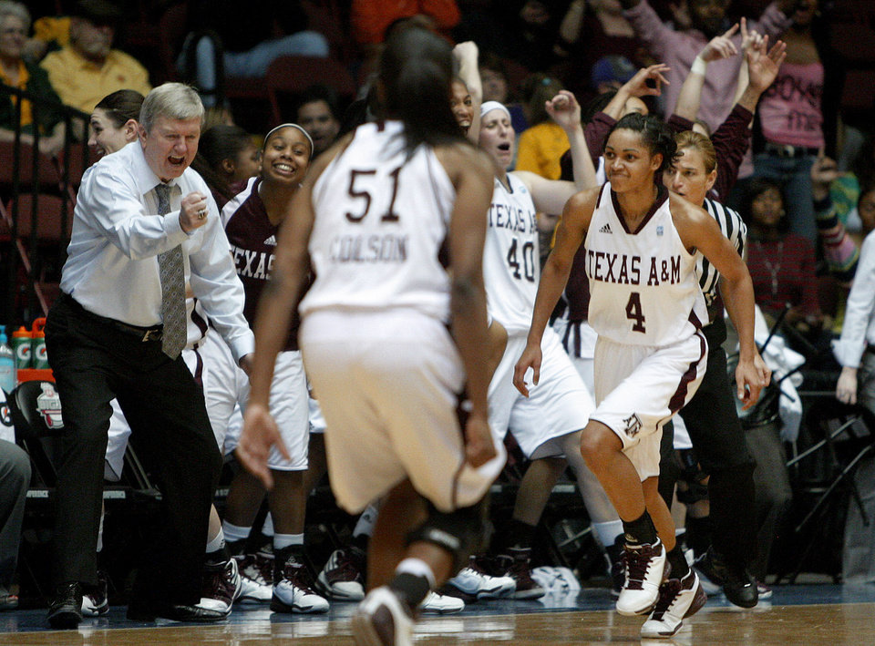 Texas A&M's Sydney Carter (4) runs past Texas A&M coach Gary Blair and the bench as they celebrate a basket during the women's college basketball Big 12 Championship tournament game between the University of Oklahoma and Texas A&M in Kansas City, Mo., Friday, March 11, 2011.  Photo by Bryan Terry, The Oklahoman
