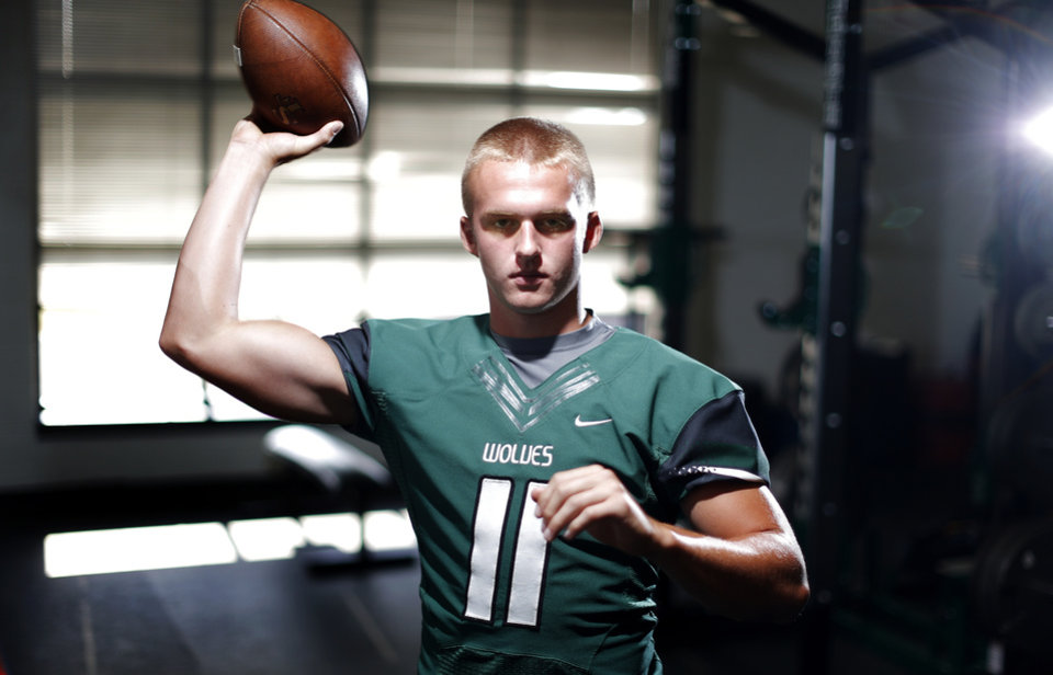 Photo - Edmond Santa Fe quarterback Justice Hansen poses for a portrait at Edmond Santa Fe for the Super 30 on Thursday, July 11, 2013. Photo by Bryan Terry, The Oklahoman