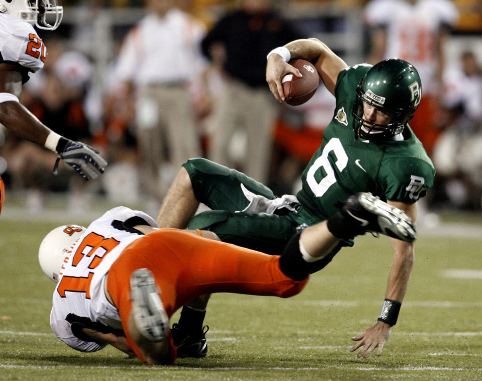 Photo - Nathan Peterson (13) tackles quarterback Blake Szymanski in the first half during the college football game between Oklahoma State University and Baylor University at Floyd Casey Stadium in Waco, Texas, Saturday, Nov. 17, 2007. BY STEVE SISNEY, THE OKLAHOMAN