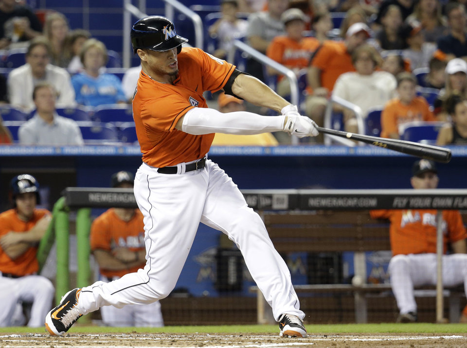 Photo - Miami Marlins' Giancarlo Stanton hits a three-run home run in the first inning off Arizona Diamondbacks starting pitcher Josh Collmenter during a baseball game, Sunday, Aug.17, 2014, in Miami. (AP Photo/Lynne Sladky)