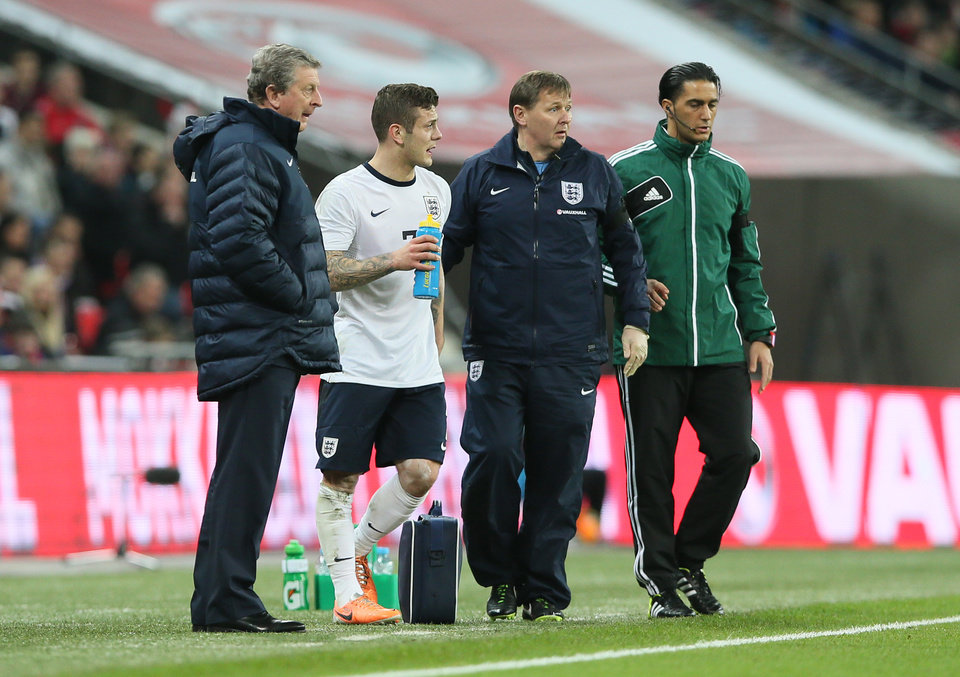 Photo - England's manager Roy Hodgson, left, gives instructions to his player England's Jack Wilshere, second left, during the international friendly soccer match between England and Denmark at Wembley stadium in London Wednesday, March  5,  2014. (AP Photo/Alastair Grant)
