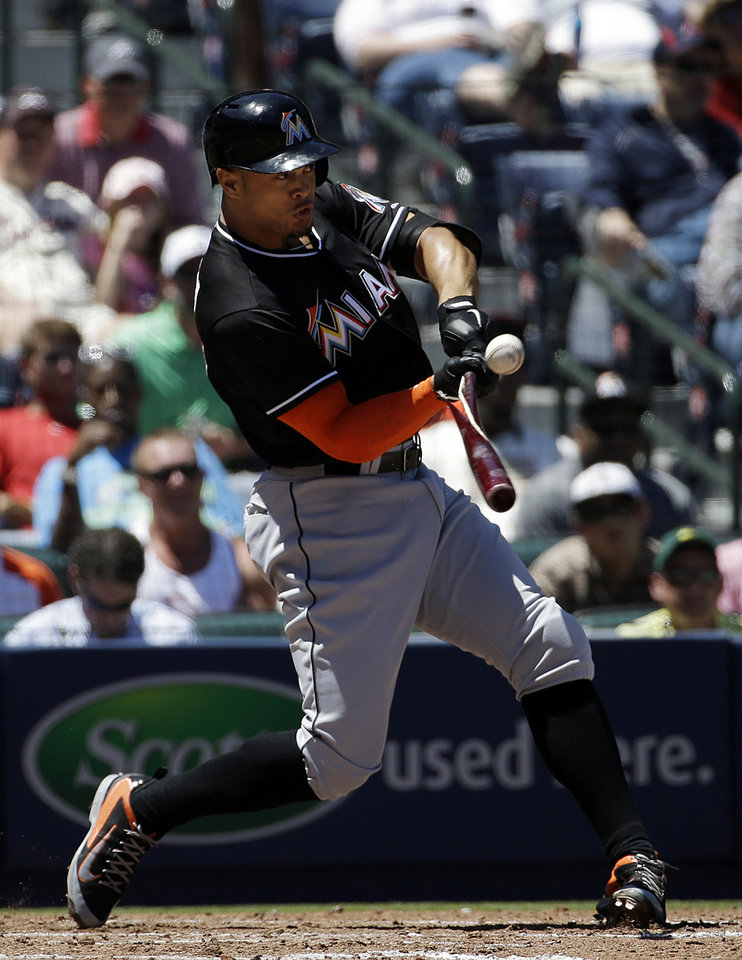 Photo - Miami Marlins' Giancarlo Stanton hits a double to score teammate Jeff Mathis in the sixth inning of a baseball game against the Atlanta Braves, Wednesday, April 23, 2014, in Atlanta. (AP Photo/David Goldman)