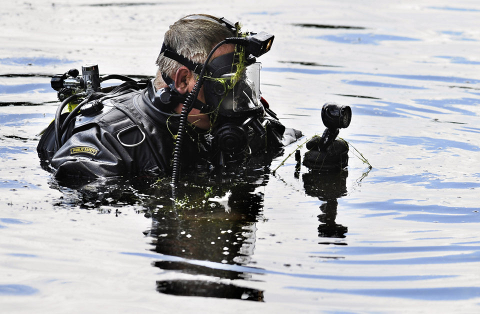 Photo - Connecticut State Police Dive Team search Pine Lake in Bristol, Conn., the hometown of the former New England Patriots player Aaron Hernandez,  Monday, July 29, 2013. Hernandez has pleaded not guilty to murder in the death of Odin Lloyd, a 27-year-old Boston semi-professional football player. (AP Photo/Jessica Hill)