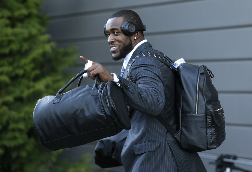 Photo - Seattle Seahawks strong safety Kam Chancellor leaves team headquarters in Renton, Wash., Sunday, Jan. 26, 2014, to board a bus for his flight to play the Denver Broncos in the NFL Super Bowl XLVIII football game in East Rutherford, N.J. (AP Photo/Ted S. Warren)