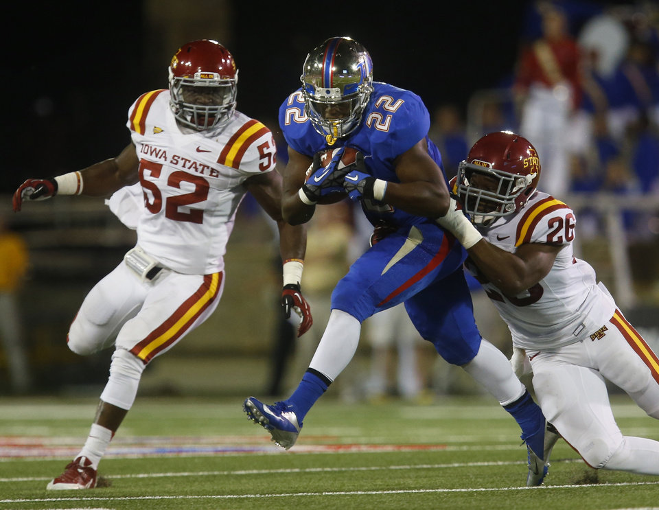 Photo - Tulsa's Trey Watts (22) is taken down by Iowa State's Deon Broomfield during the first half of an NCAA college football game, Thursday, Sept. 26, 2013 in Tulsa, Okla. (AP Photo/Tulsa World, Tom Gilbert)  ONLINE OUT; TV OUT; TULSA OUT
