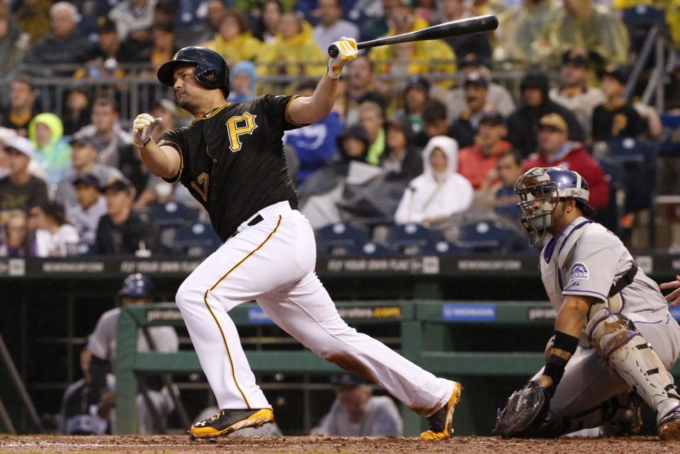 Photo - Pittsburgh Pirates' Gaby Sanchez drives in a run with a double off Colorado Rockies starting pitcher Brett Anderson during the fourth inning of a baseball game in Pittsburgh Saturday, July 19, 2014. (AP Photo/Gene J. Puskar)