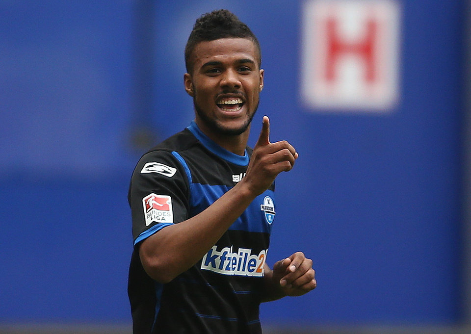 Photo - Paderborn's Elias Kachunga celebrates his opening goal during the German Bundesliga soccer match between Hamburger SV and SC Paderborn in Hamburg, northern Germany, Saturday Aug. 30, 2014. (AP Photo/dpa, Axel Heimken)
