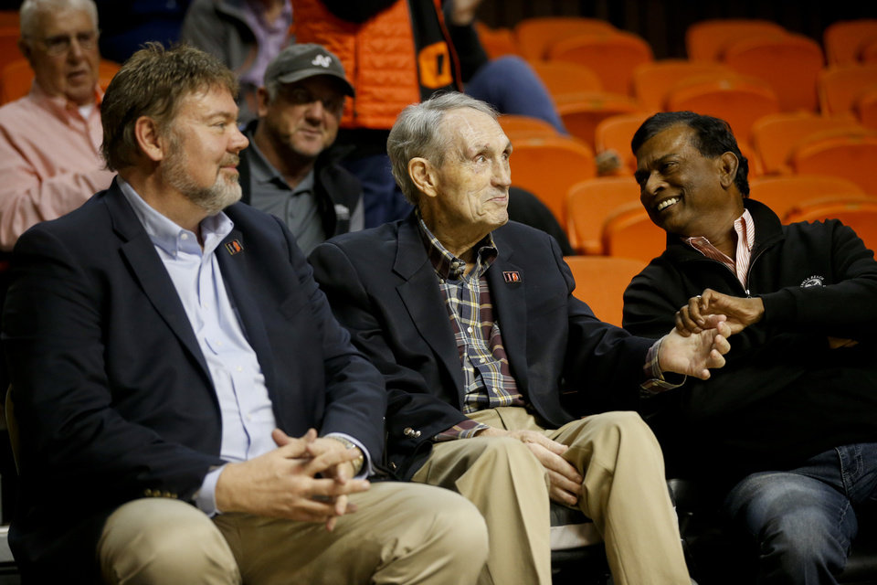 Photo - Former Oklahoma State basketball coach Eddie Sutton shakes hands with a fan during the NCAA men's basketball game between the Oklahoma State Cowboys and the Oral Roberts Golden Eagles at Gallagher-Iba Arena in Stillwater, Okla. on Thursday, November 16, 2017. IAN MAULE/Tulsa World