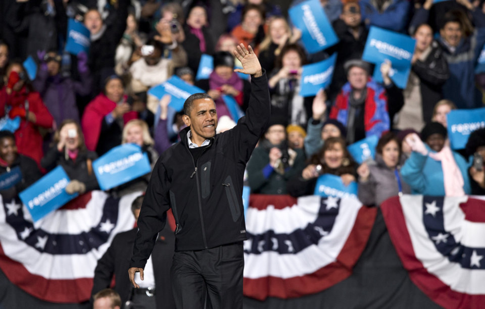 In the final hours of a four-state campaign day, President Barack Obama arrives at a rally at Jiffy Lube Live arena, late Saturday night, Nov. 3, 2012, in Bristow, Va. Virginia is one of the most closely contested battleground states. (AP Photo/J. Scott Applewhite)
