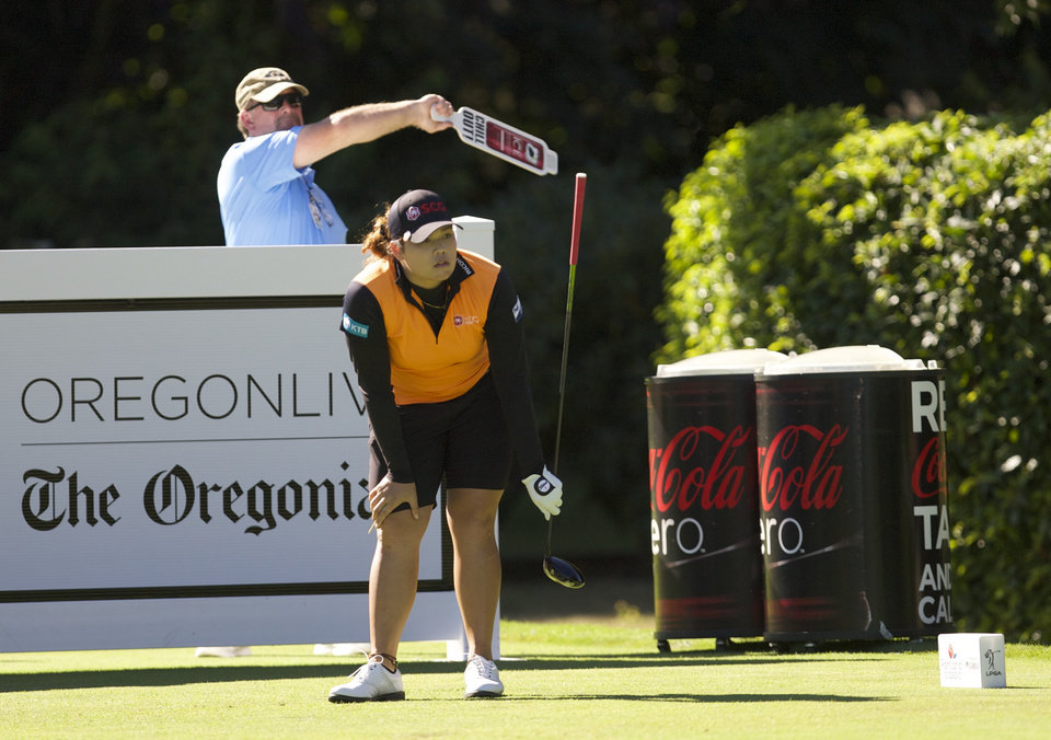Photo - Ariya Jutanugarn, of Thailand, watches a wayward drive on the ninth hole in the first round of the Portland Classic golf Tournament,Thursday, Aug. 28, 2014, in Portlad, Ore. (AP Photo/The Oregonian, Michael Lloyd) MAGAZINES OUT; TV OUT; LOCAL TELEVISION OUT; LOCAL INTERNET OUT; THE MERCURY OUT; WILLAMETTE WEEK OUT; PAMPLIN MEDIA GROUP OUT