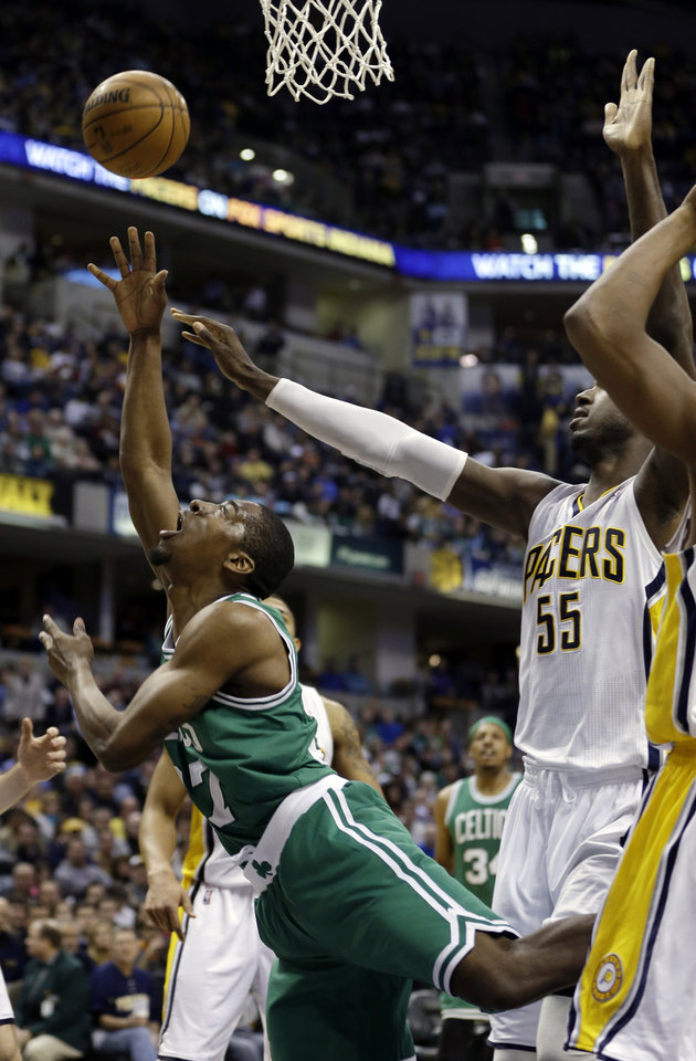 Boston Celtics' Jordan Crawford (27) shoots against Indiana Pacers' Roy Hibbert (55) during the first half of an NBA basketball game Wednesday, March 6, 2013, in Indianapolis. (AP Photo/Darron Cummings)