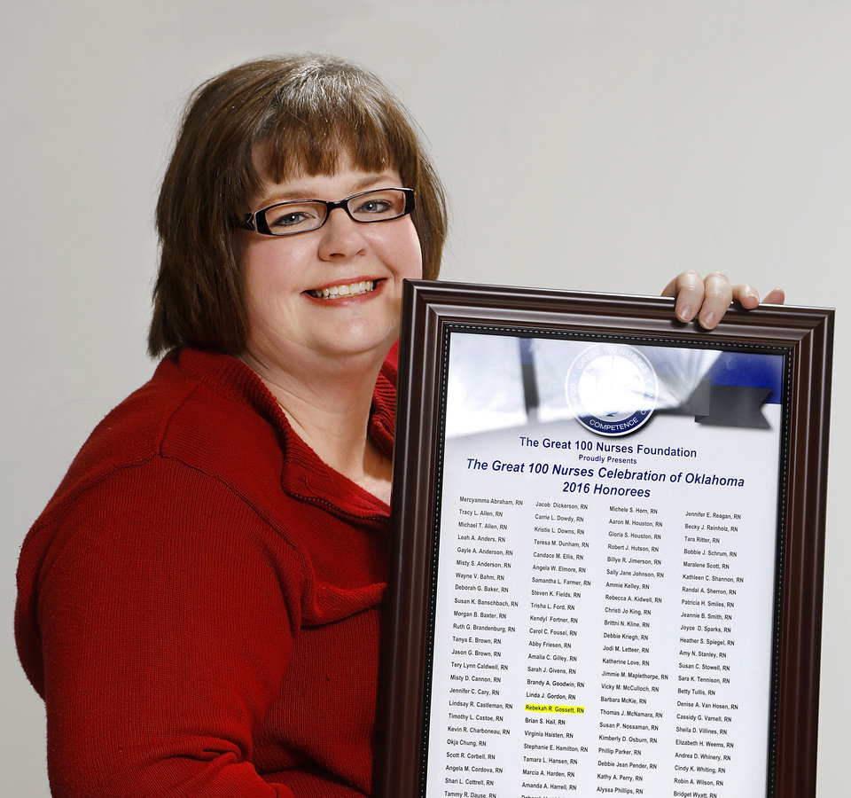Photo -  Rebekah Gossett, population care management supervisor at the Oklahoma Health Care Authority, was recently named a 2016 Great 100 Nurses honoree. She is shown with her Great Nurses plaque at the health care authority's office in Oklahoma City. [Photo by Jim Beckel, The Oklahoman]