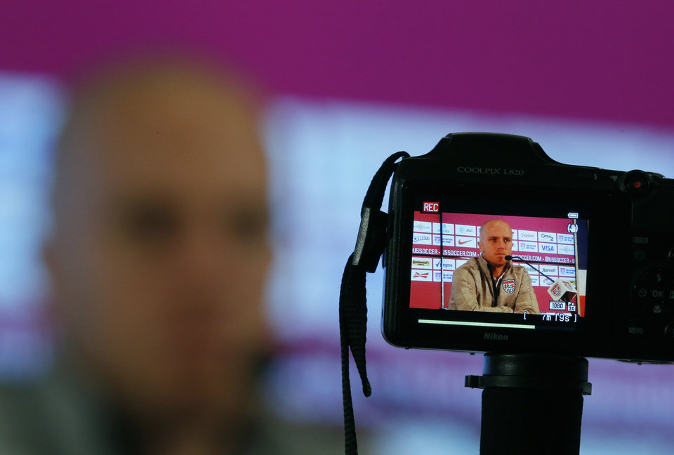Photo - United States' Michael Bradley is seen on the back of a camera as talks during a press conference before a training session in Sao Paulo, Brazil, Friday, June 20, 2014. The U.S. will play against Portugal in group G of the 2014 soccer World Cup on June 22. (AP Photo/Julio Cortez)